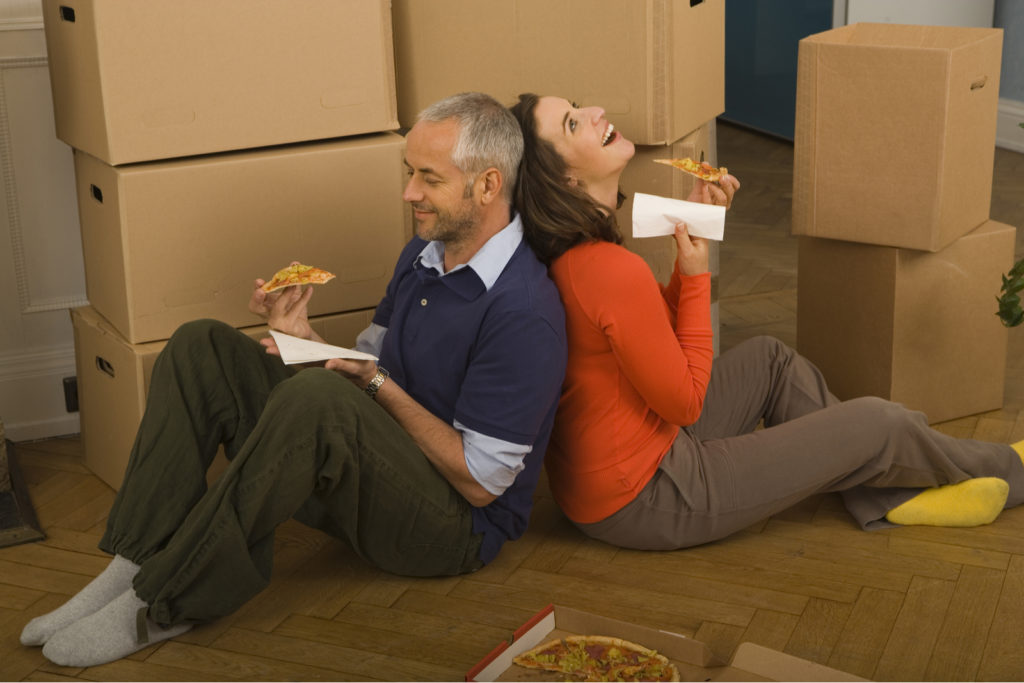 Couple Eating Food While Moving House