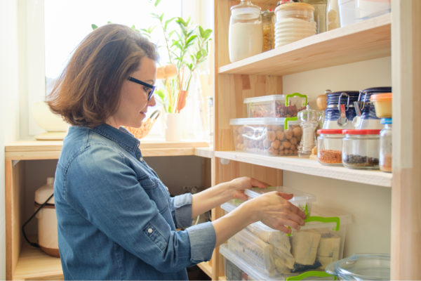 Woman Sorting Pantry