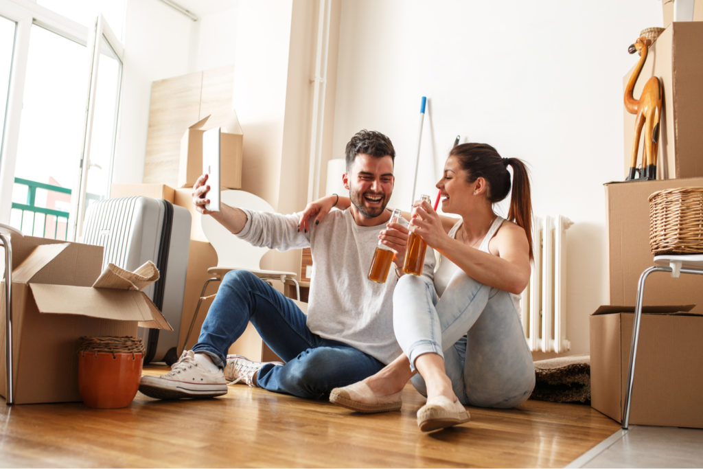 Young Couple After Moving Into First Home